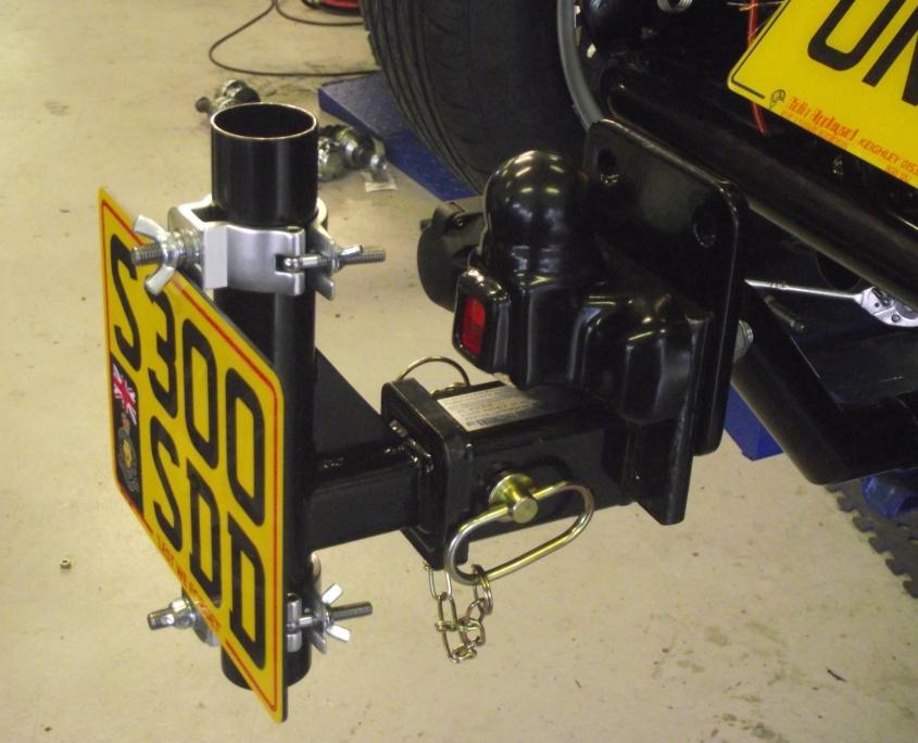 Flag pole receiver option on tow-bar